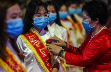 COVID-19: Buddhist followers wear face masks while attending Vu Lan Festival