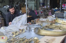 Village in northern Vietnam repairing trumpets for generations