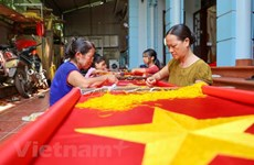 Visiting the village with more than 70 years of sewing national flags