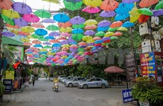 Hanoi's street decorated with colourful umbrellas