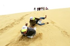 Great fun sand boarding in Nui Ne
