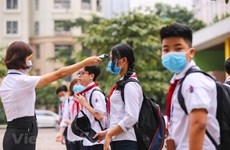 Hanoi students back to school after coronavirus closures