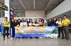 Passengers experience first flight by Vietravel Airlines