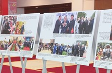 Photo exhibition celebrates National Party Congress