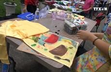 Children show love for Ao dai through drawings