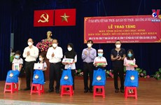 Tablets presented to help disadvantaged students in HCMC study online