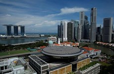 Singapore lowers economic growth forecast