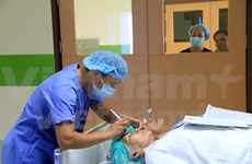 HCM City doctors give eye surgery to Lao patients