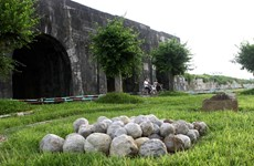Exhibition spotlights Ho Citadel archeological excavations