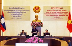 Vietnam, Laos share experience in management decentralisation