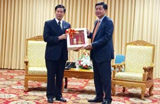 HCM City, Lao capital step up cooperation