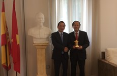 Hanoi's front officials visit Switzerland and Spain