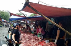 Firms promote pork demand, farmers struggle