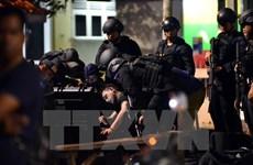 Suspected militant shot dead after stabbing Indonesian policemen