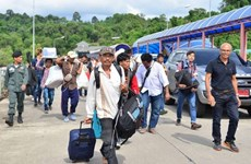 Thousands of foreign workers in Thailand return home