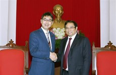 Party official greets special advisor to Japanese PM