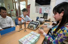Reference exchange rate down 1 VND