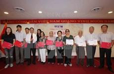 Vietnam News Agency marks Day of Invalids, Martyrs