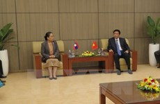 NA Offices of Vietnam, Laos tighten ties