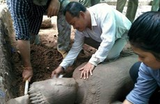 Large ancient statue unearthed in Cambodia's Angkor complex