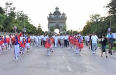 Laos holds mini-marathon to celebrate 50th ASEAN anniversary
