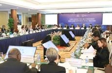 APEC officials continue to debate economic, health issues