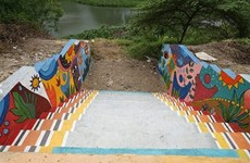Students create river side art space