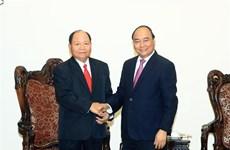 PM lauds Vietnam- Laos cooperation in home affairs
