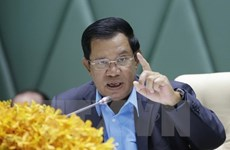 Cambodian PM vows to take hard line with treason