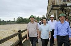 President Tran Dai Quang visits storm-hit families