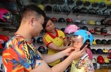 Helmet law needs reinforcement