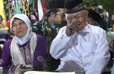 Indonesian couples celebrate New Year with mass wedding