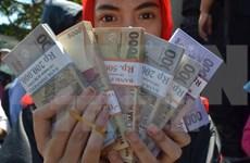 Malaysian Ringgit climbs 10 percent against USD