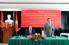 Laos provides financial relief for typhoon-hit people in Vietnam