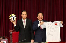 PM presents U23 team's ball, shirt for auction to raise funds for the poor