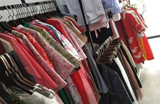 Young people shop for affordable, ready-to-wear ao dai for Tet