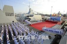 Flag-hoisting ceremony held on two missile escort warships
