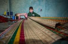 New machines revive mat weaving village