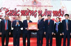 PM lauds workers' contributions to national development