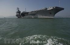 Vietnam officials visit US aircraft carrier
