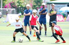 English football coaches train kids in Vietnam