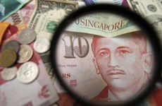 Singapore tightens monetary policy
