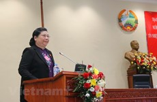 Vietnam share experiences in taking votes of confidence with Laos