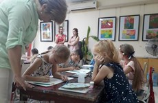 Vietnamese, foreign children draw peaceful Hanoi