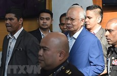Former Malaysian PM brought to court over corruption scandal