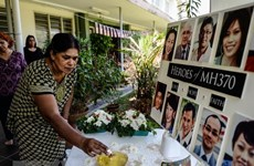 Malaysia to release report on missing flight MH370