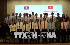 Quang Tri, Lao border province review cooperation