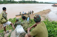 Laos dam collapse: rescuers searching for missing victims