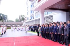 Flag raising ceremony in Laos celebrates ASEAN's 51st anniversary