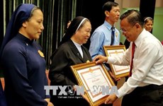 HCM City honours exemplary Catholics in charity work